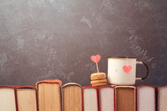Valentines day concept with retro tea cup and macarons dessert on books Royalty Free Stock Photography