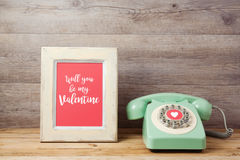 Valentines day concept with retro telephone and photo frame Stock Image