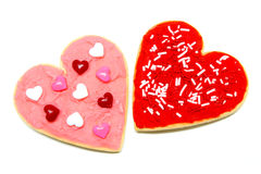 Valentines Day cookies. A couple of colorful heart-shaped Valentines Day cookies over white Stock Photography