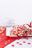Valentines Day cookies and a cup on white background. Heart shaped cookes and teacup for party Royalty Free Stock Photography