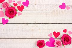 Valentines Day corner frame of hearts and roses against rustic white wood Royalty Free Stock Photos
