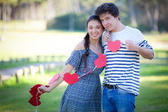 Valentines day couple. Happy loving valentines day couple with valentine hearts Royalty Free Stock Image
