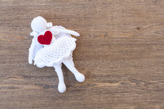 Valentines day crochet angel and two hearts on wooden table Stock Images