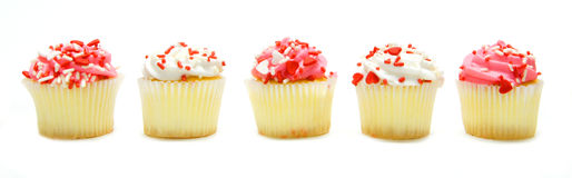 Valentines Day cupcakes. Group of colorful Valentines Day cupcakes arranged in a row as a border Royalty Free Stock Photography