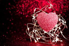 Valentines day dark red Red heart with light background.Sparkling glittering maroon,burgundy black color night light elegance,smoo. Th backdrop,artwork design royalty free stock image