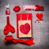 Valentines day or Dating festive flat lay in red color love symbols: with hearts, candles, gifts, book, ribbon and red lock with Stock Photo