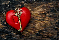 Valentines Day decoration Red heart golden key Stock Photo
