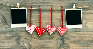 Valentines Day decoration. Red hearts and photo frame Royalty Free Stock Images