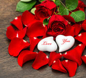 Valentines Day decoration red roses and two hearts Royalty Free Stock Images