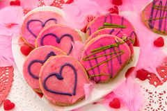 Valentines Day - decorations and cookies with pink frosting and Stock Photography