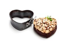 Valentines  day dessert. Heart  shaped chocolate cake and metal f Stock Image