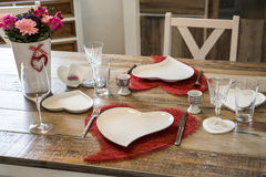 Valentines day dinner setting romantic love for two wooden table red heart shape Copy space Royalty Free Stock Photography