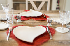 Valentines day dinner setting romantic love for two wooden table red heart shape Copy space Stock Photography