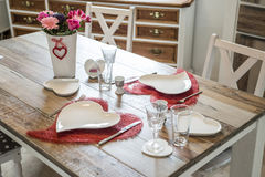 Valentines day dinner setting romantic love for two wooden table red heart shape Copy space Stock Photo