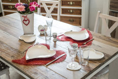 Valentines day dinner setting romantic love for two wooden table red heart shape Copy space Royalty Free Stock Images