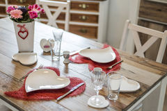 Valentines day dinner setting romantic love for two wooden table red heart shape Copy space. Valentines day dinner with setting romantic love for two wooden Stock Images