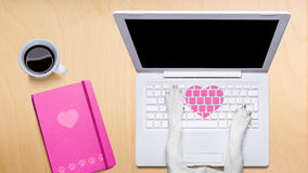 Valentines day dog, dating online on a chat. Dog office worker in  love on happy valentines day,  typing in a  pc computer laptop,   on desk  background, dating Royalty Free Stock Photos