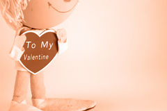 Valentines Day Doll with Heart Saying To My Valentine. A vintage doll holds a sign that says: To My Valentine Royalty Free Stock Photo