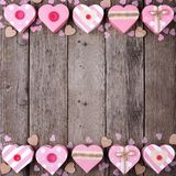 Valentines Day double border of pink rustic heart-shaped gift boxes Royalty Free Stock Images