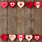 Valentines Day double border of red heart-shaped gifts over wood Royalty Free Stock Photos