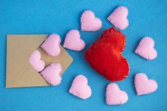 Valentines day envelope with hearts on blue background. Love letter or invitation. Valentines day envelope with toy hearts on blue background. Romantic love Royalty Free Stock Photography