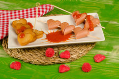 Valentines Day fast food with sausages stock photo