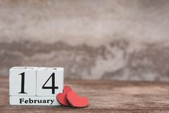 Valentines day with february 14th. Wooden white block calendar on wood table background with copy space stock photos