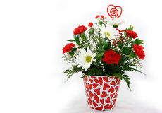 Valentines Day Flower Bouquet. A Floral bouquet of white daisies and red carnations in a flower pot decorated with red hearts Royalty Free Stock Photos