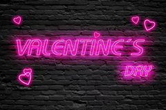 Valentines day. fluorescent Neon tube Sign on dark brick wall. Front view. Can be used for online banner ads or background. Stock Images