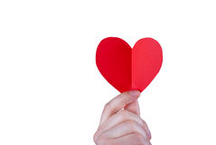 Valentines Day. Folded red paper heart held in hand Stock Images