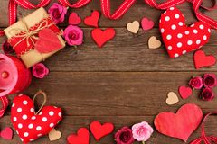 Valentines Day frame of hearts, gifts, flowers and decor on rustic wood Royalty Free Stock Photos