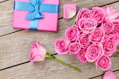 Valentines day with gift box full of pink roses Stock Photo