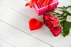 Valentines day gift box pink on white table background / Romantic red heart valentines red roses royalty free stock photo