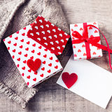 Valentines day  Gift box with red bow ribbon, paper and hearts o Royalty Free Stock Image