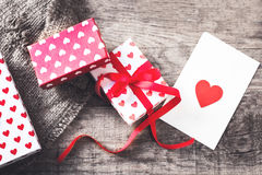 Valentines day Gift box with red bow ribbon, paper and hearts on Royalty Free Stock Images