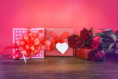 Valentines day gift box red and pink on wood Valentines day red rose flower Red Heart Love concept and gift box royalty free stock photos
