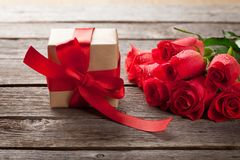 Valentines day gift box and red roses Stock Images