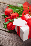 Valentines day gift box and red tulips Royalty Free Stock Images