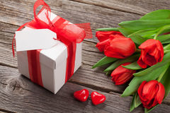 Valentines day gift box and red tulips Stock Photo