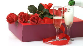 Valentines day gift. Roses, gift box and champagne over white stock video footage