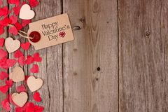 Valentines Day gift tag and heart side border on wood Royalty Free Stock Photos