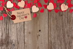 Valentines Day gift tag with heart top border on wood Stock Photography