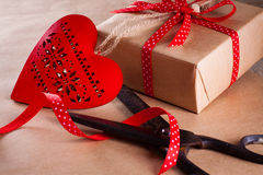 Valentines day gift. Valentines day gift wrapping with boxes and scissors over paper or wooden background Stock Photography