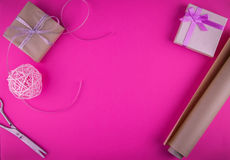 Valentines day gift wrapping on pink background. Royalty Free Stock Image