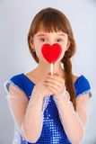Valentines day girl. Beautiful child girl  holding a lollipop in the shape of a red heart valentines day Stock Photos