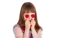 Valentines day girl. Beautiful child girl  holding a lollipop in the shape of a red heart valentines day Royalty Free Stock Photography
