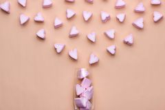 Valentines Day Glass with lots of candy hearts marshmallows Royalty Free Stock Image