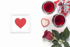 Valentines Day with a glass of red wine, gift, candles view from above Royalty Free Stock Image