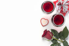 Valentines Day with a glass of red wine, gift, candles view from above Stock Images