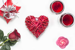 Valentines Day with a glass of red wine, rose, gift, candles and heart view from above Stock Photos